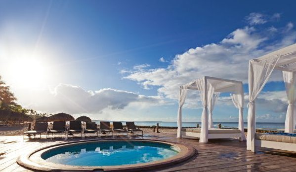 Luxury hotel hot tub and cabanas on the beach