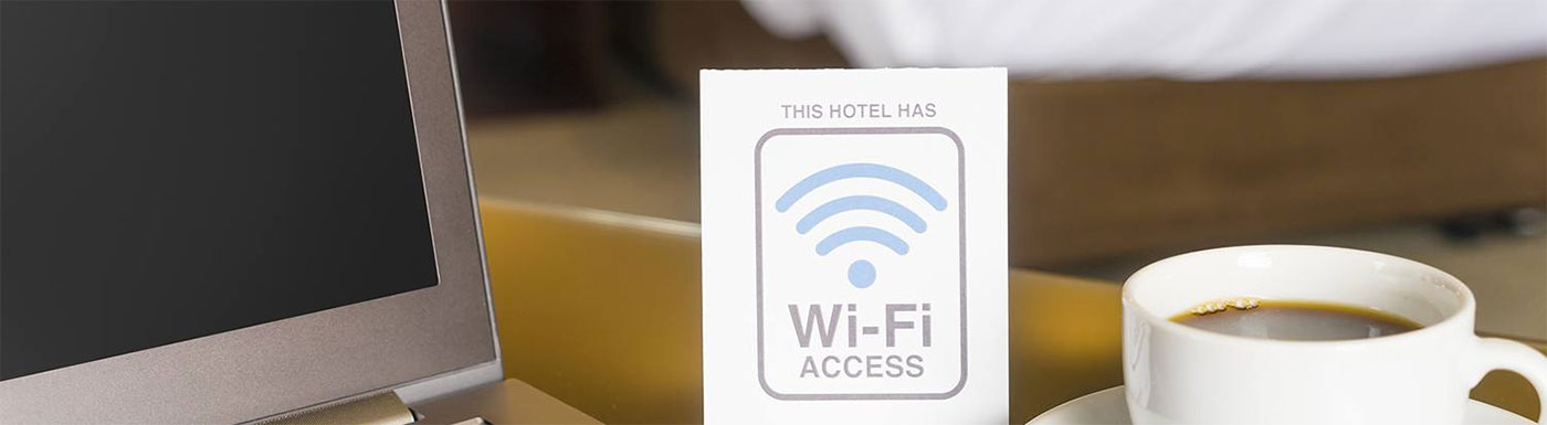 "Laptop with cup of coffee ""This hotel has Wi-Fi access"""