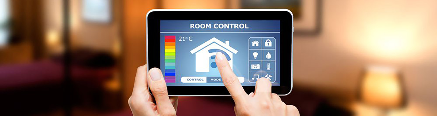 Hotel guest using their mobile phone to control the hotel room's thermostat
