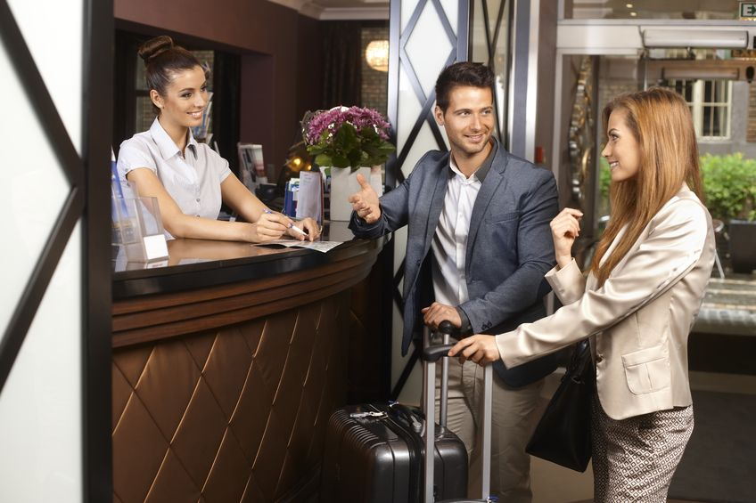 Business Professionals at Hotel Reception Check-in