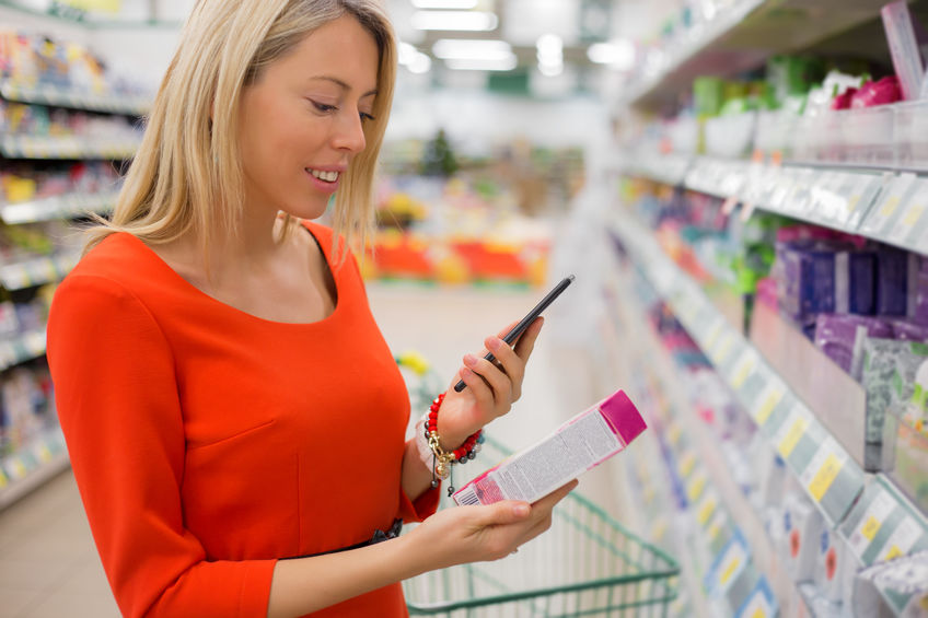 Women shopping and using mobile phone to read product reviews